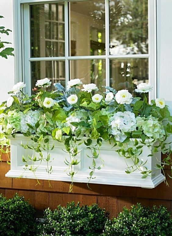 10-a-chic-white-window-box-planter-with-white-flowers-and-cascading-greenery-brings-ultimate-elegance